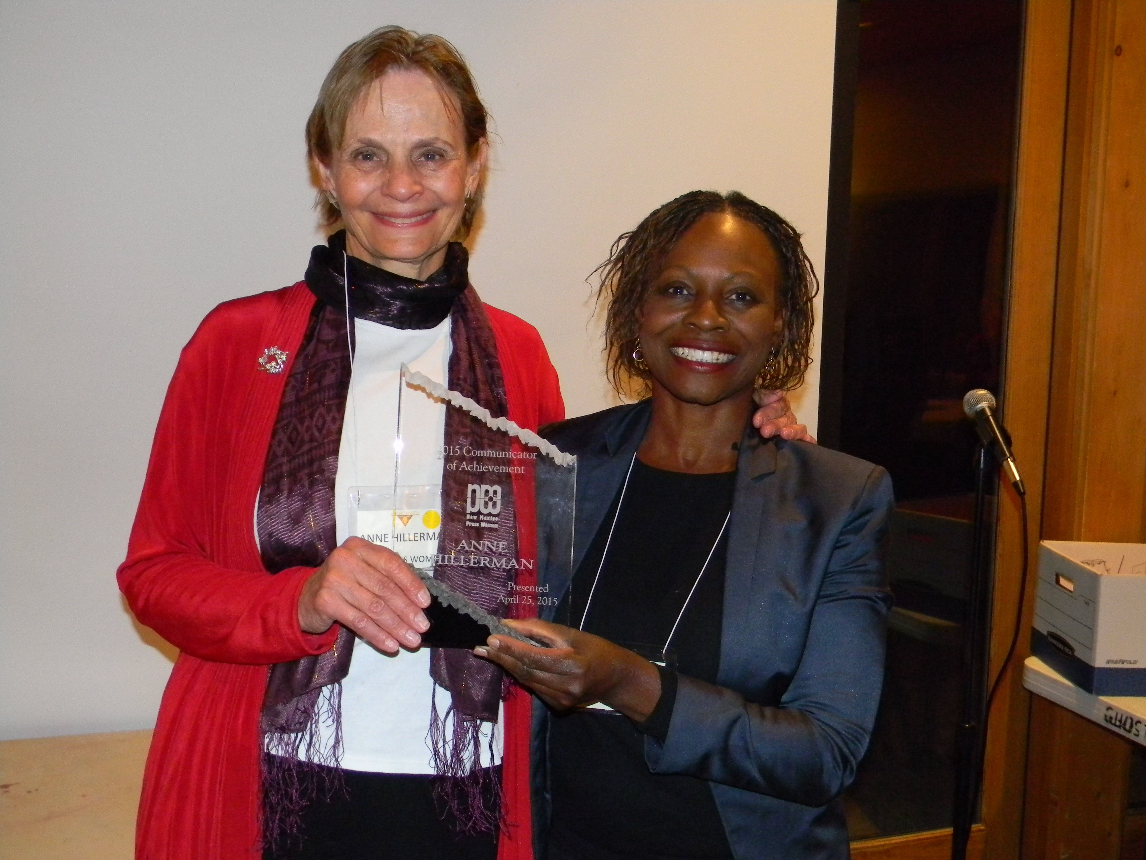 Anne Hillerman accepting the CoA award from NMPW Conference Chair Sherri Burr at the 2015 NMPW Conference at Ghost Ranch