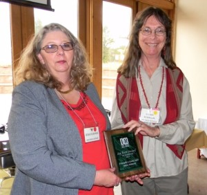 Sherry Robinson accepting her first runner-up Zia award from Jessica Savage, Zia Award Chair