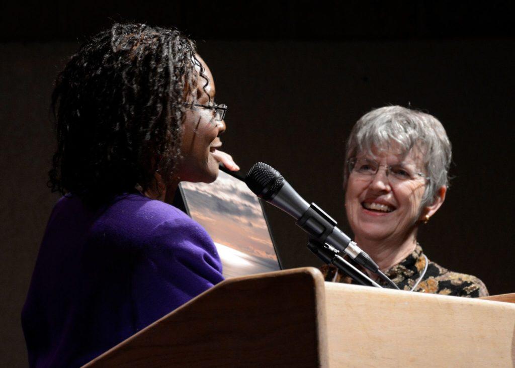 NMPW President Sherri Burr (l) presents outgoing NMPW president Loretta Hall with award