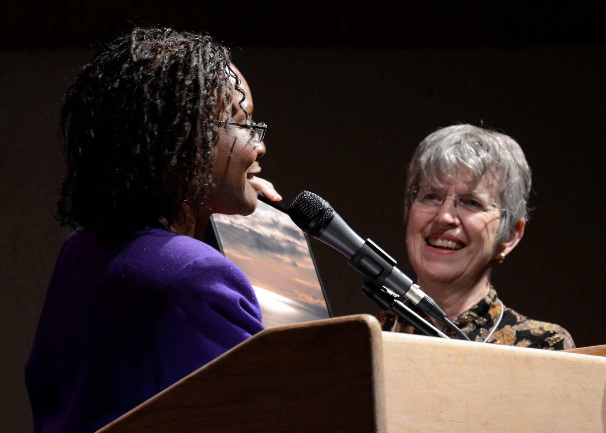 NMPW President Sherri Burr (l) presents outgoing NMPW president Loretta Hall with award